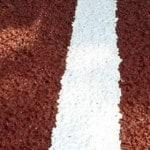 Напольное резиновое спортивное покрытие.