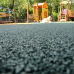 Покрытие для детских площадок из резиновой крошки.