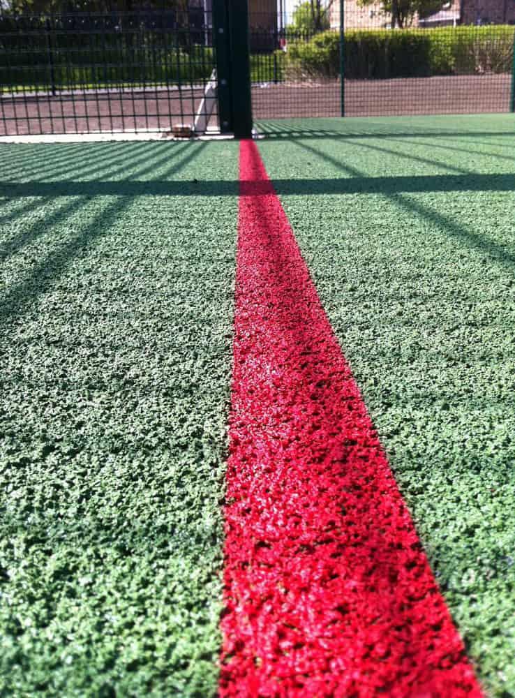 Резиновое покрытие для спортивных площадок.
